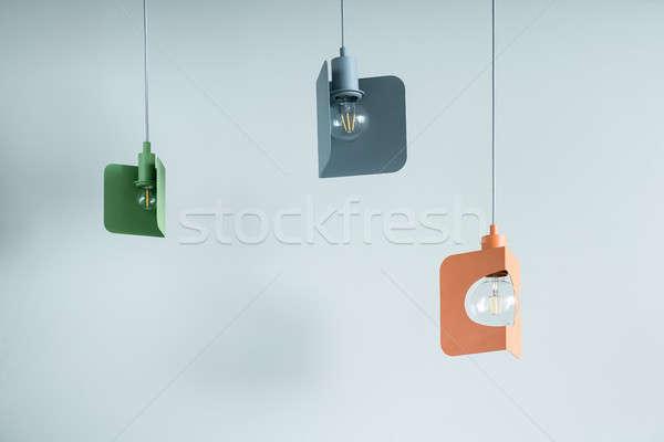 Hanging metal colorful edison lamps Stock photo © bezikus