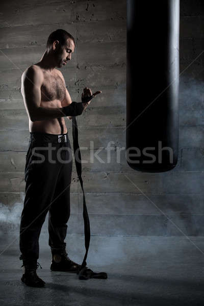 Boxer pulls bandages for boxing Stock photo © bezikus