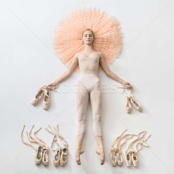 Pretty ballerina lies in studio Stock photo © bezikus
