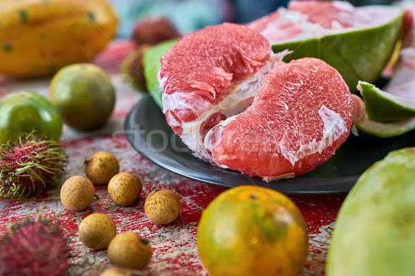 Gustoso esotiche frutta colorato legno Foto d'archivio © bezikus