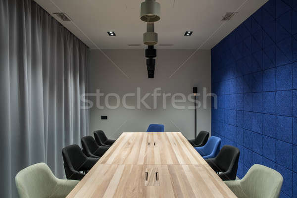 Stylish conference room with gray and blue walls Stock photo © bezikus