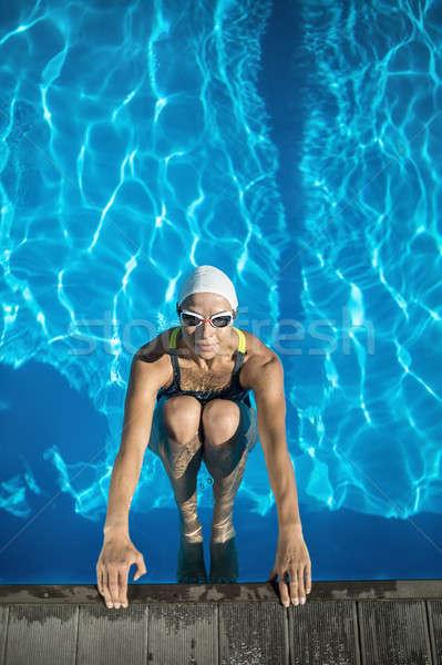 Athletic girl in the swim pool Stock photo © bezikus