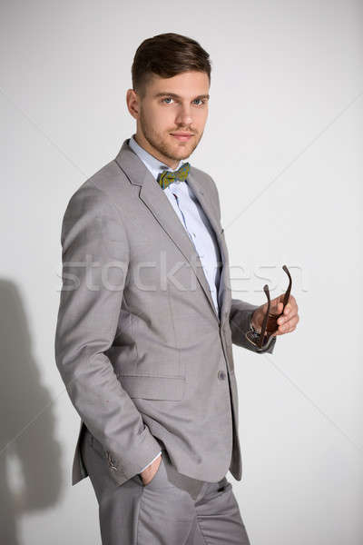 Atractivo hombre traje empate mariposa vestido Foto stock © bezikus