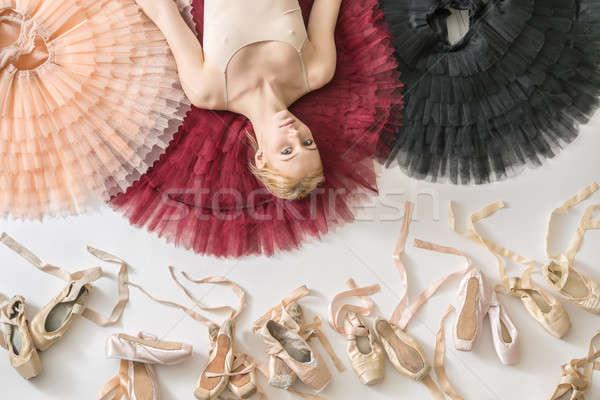 Blonde ballerina lies in studio Stock photo © bezikus