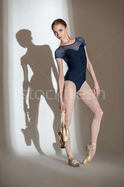 Full growth portrait of the graceful ballerina in a studio with  Stock photo © bezikus
