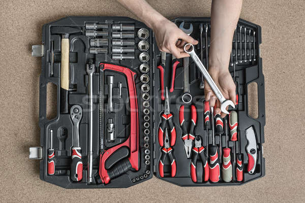 Open toolbox and male hands  Stock photo © bezikus