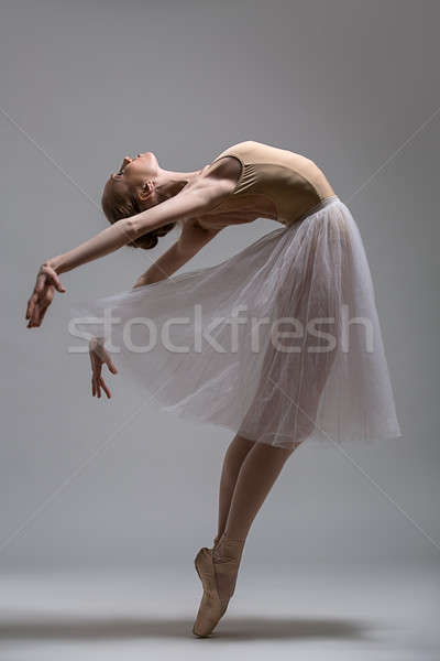 Graceful ballerina standing on toes bending the back Stock photo © bezikus