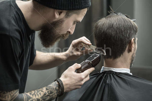 Cutting hair in barbershop Stock photo © bezikus