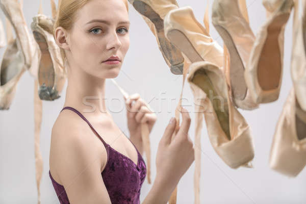 Blonde ballerina and pointe shoes Stock photo © bezikus