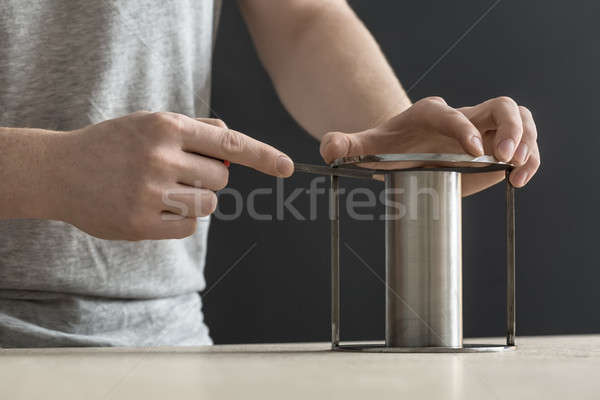 Man with cylindrical metal construction Stock photo © bezikus