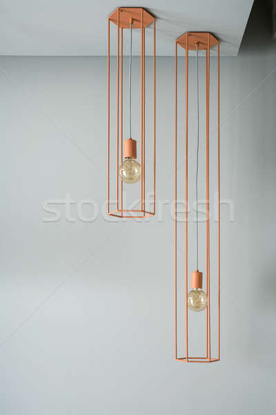 Hanging orange edison lamps Stock photo © bezikus