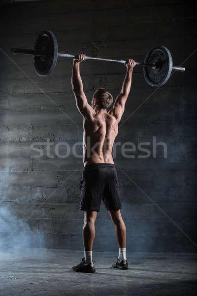 Athlète barbell exercice coup gymnase club Photo stock © bezikus
