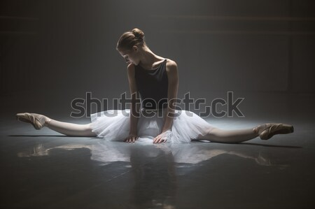 Seated ballerina in class room Stock photo © bezikus