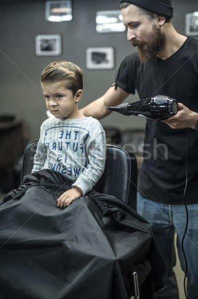 Small kid in barbershop Stock photo © bezikus