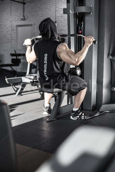 Strong man's workout in gym Stock photo © bezikus