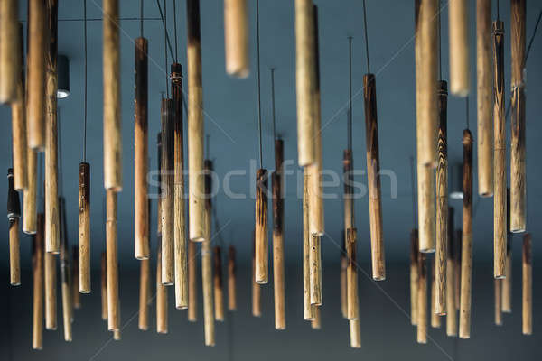 Hanging wooden tubes Stock photo © bezikus