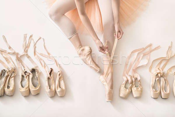 Ballerina is dressing in studio Stock photo © bezikus