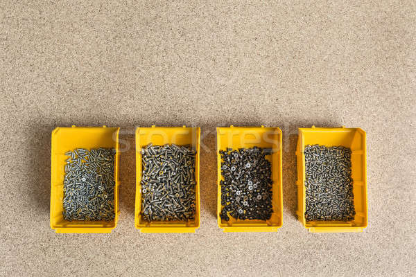 Plastic boxes with screws Stock photo © bezikus