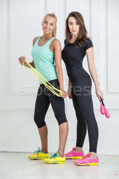 Girls with sports equipment Stock photo © bezikus