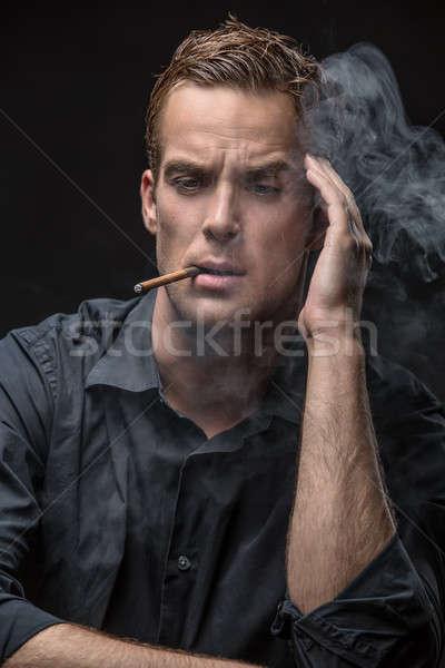 Portrait of man with cigarette Stock photo © bezikus