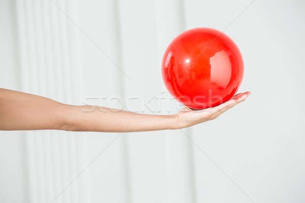 Rood bal ritmisch gymnastiek vrouwelijke hand Stockfoto © bezikus