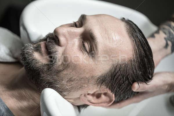 Mosás fej derűs férfi szakáll hazugságok Stock fotó © bezikus