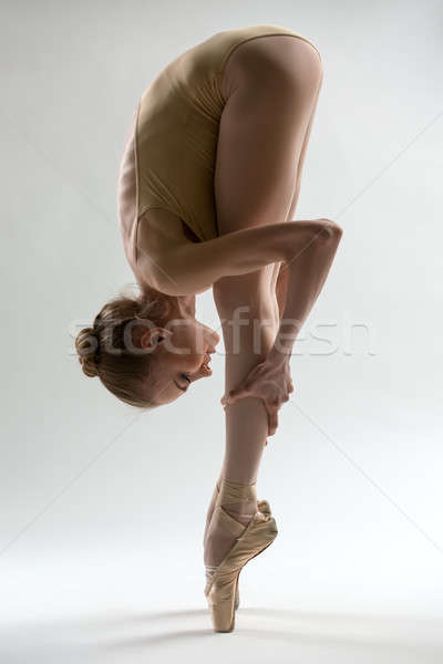 Fragile ballerina takes a deep slope forward Stock photo © bezikus