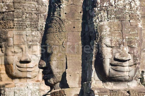 Angkor sorridente faces templo famoso lugar Foto stock © bezikus
