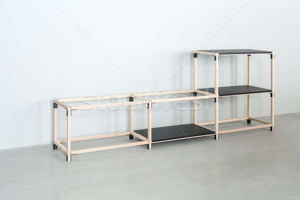 Light wooden construct with black tabletops Stock photo © bezikus