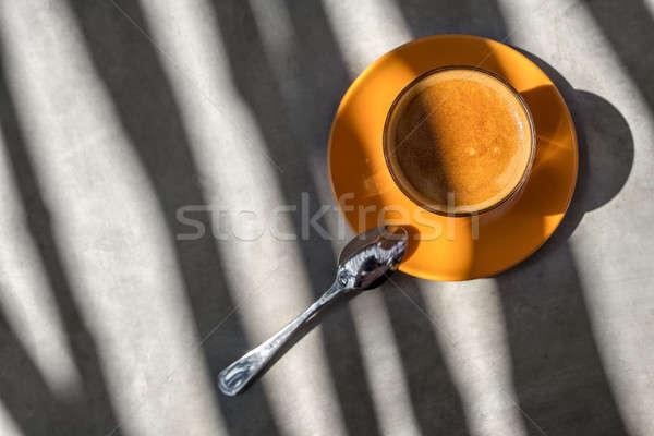 Caffè bere vetro piattino arancione tavola Foto d'archivio © bezikus