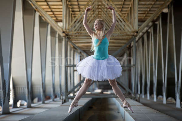 Stock photo: Graceful ballerina in the industrial background