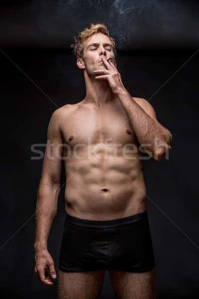 Smoking guy in underpants Stock photo © bezikus