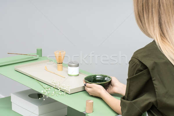 Girl with bowl sits at table Stock photo © bezikus