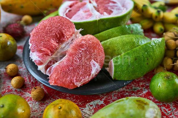 Színes egzotikus gyümölcs finom rongyos fából készült Stock fotó © bezikus