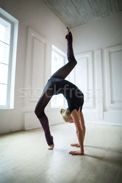 Flexible gymnast doing exercise Stock photo © bezikus