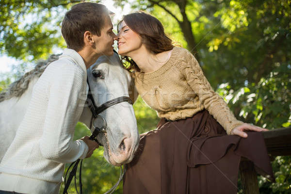 Young couple riding Stock photo © bezikus