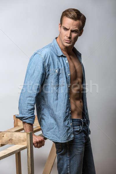 Homem camisas muscular cara azul brim Foto stock © bezikus