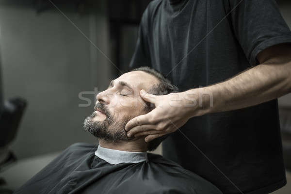 Face massage in barbershop Stock photo © bezikus