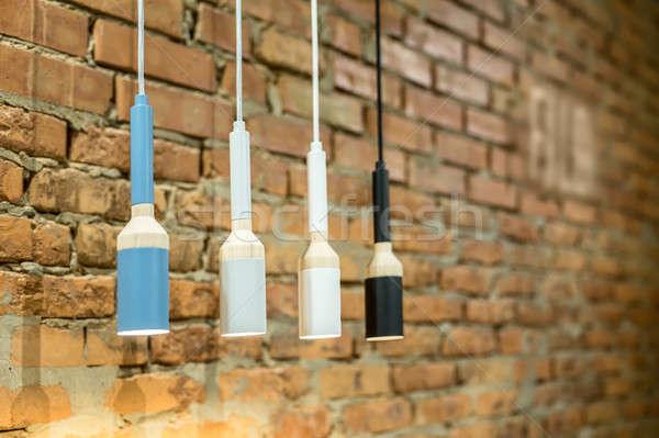 Lampes grenier style quatre suspendu Photo stock © bezikus