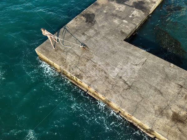 Girl posing on seafront Stock photo © bezikus