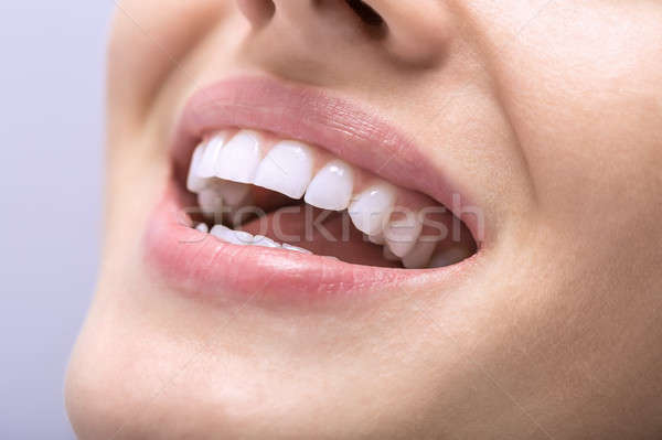 Macro photo of white teeth Stock photo © bezikus