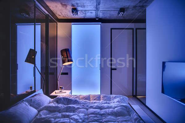 Yatak odası çatı katı stil düşük ışık duvarlar Stok fotoğraf © bezikus