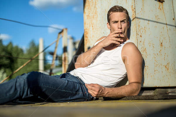 Brutal guy with cigarette Stock photo © bezikus