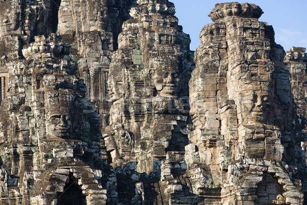 Faces angkor sorridente templo famoso lugar Foto stock © bezikus