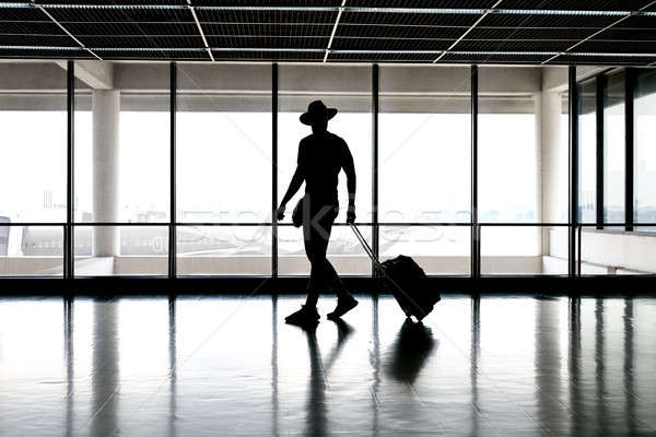 Man in hat in airport Stock photo © bezikus
