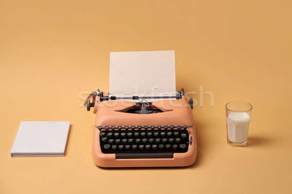 Composition with typewriter, book and glass. Studio shoot. Stock photo © bezikus