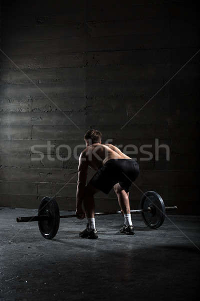 Portrait of a handsome athlete from behind Stock photo © bezikus