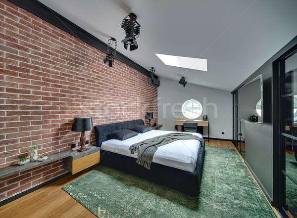 спальня современный стиль кирпичная стена зеленый ковер Сток-фото © bezikus