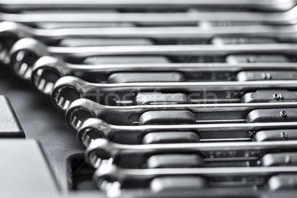 Chrome metal spanners in toolbox Stock photo © bezikus