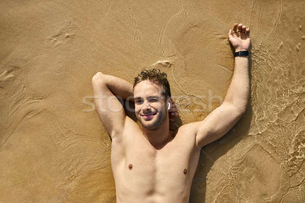 Tanned guy on beach. Daylight morning shooting. Stock photo © bezikus